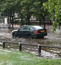 Photograph of a flooded road in Newcastle upon Tyne, 2012